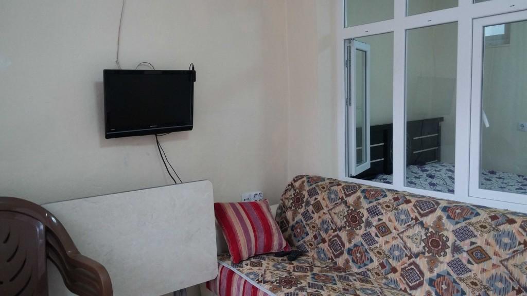 ciftehan cevik pansiyon 1+1 oda içi fotoğraf-LCD TV ve oturma odası-4